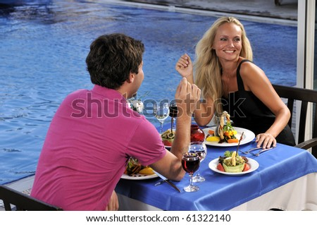 An attractive young woman on romantic date with her sweetheart - a series of RESTAURANT images. - stock photo