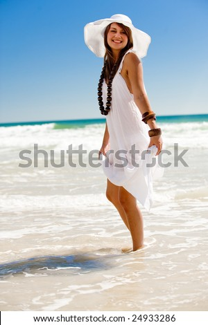 An attractive young woman on the beach