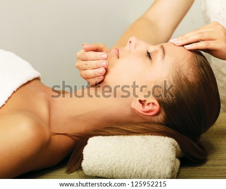 An attractive young woman receiving massage