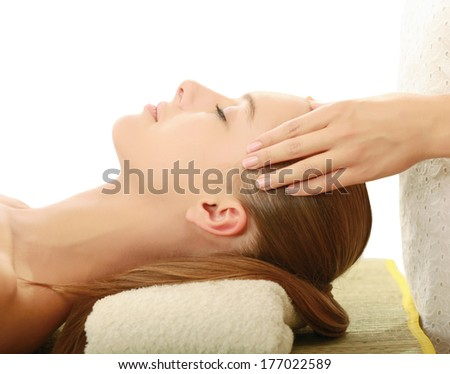 An attractive young woman receiving massage - stock photo