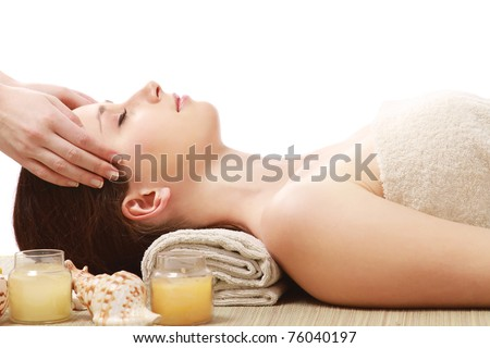 An attractive young woman receiving massage, side-view - stock photo
