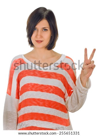 An attractive young woman showing sign of victory on white background - stock photo