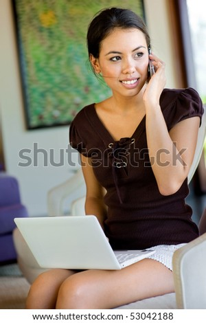 An attractive young woman using her laptop indoors