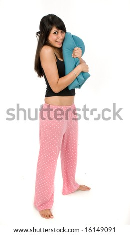 An attractive young women hugging a pillow - stock photo