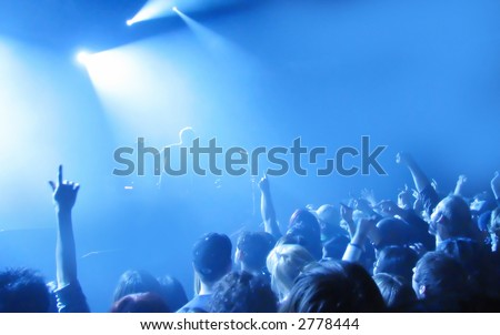 An Audience cheering for their favorite musician - stock photo