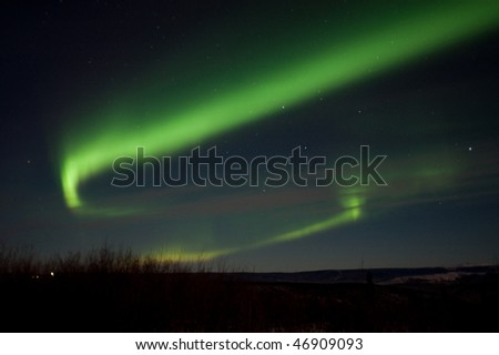 An aurora sub-storm flared up for a few minutes around 1:30 am on January 4th, 2010. The picture was taken northeast of Fairbanks, AK. - stock photo