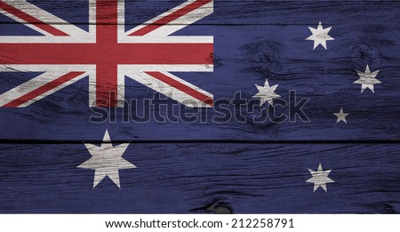 An Australian flag on a rustic wooden background. - stock photo