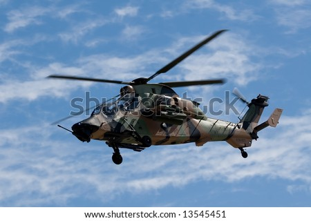 An Australian Tiger Helicopter hovering while on patrol - stock photo