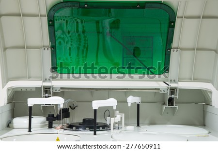 An automated analyzer is a medical laboratory instrument designed to measure different chemicals and other characteristics in a number of biological samples quickly, with minimal human assistance. - stock photo