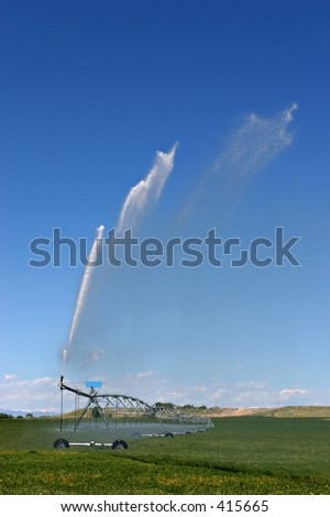 an automated irrigation system in rural wyoming - stock photo