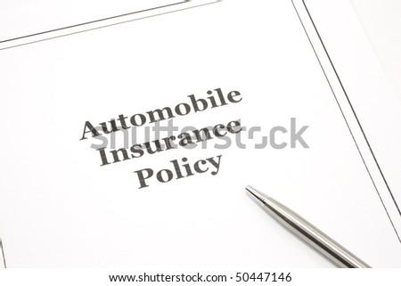 An automobile insurance policy with a pen ready to be signed. - stock photo