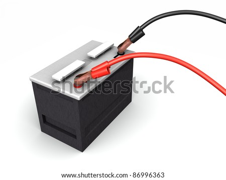 An automotive battery being recharged with battery cables sitting on a white surface - stock photo