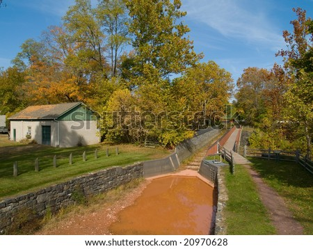 An Autumn view of a historic dike located in Bucks County, Pennsylvania. - stock photo