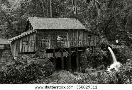 An autumn view of the Cedar Creek Gristmill outside of Woodland, Washington. - stock photo