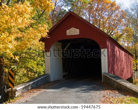 An Autumn view of the historic Knechts Covered Bridge in rural Bucks County, Pennsylvania. - stock photo