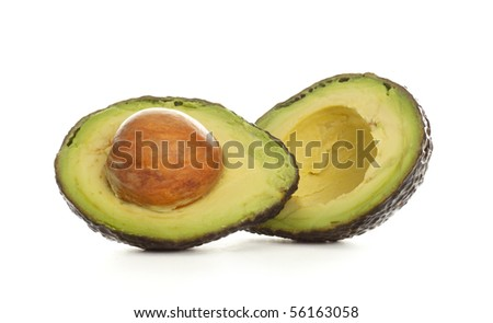 An Avocado sliced in half with seed remaining.
