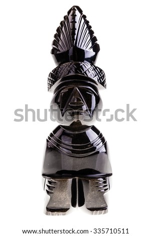 an aztec obsidian ancient statuette isolated over a white background - stock photo