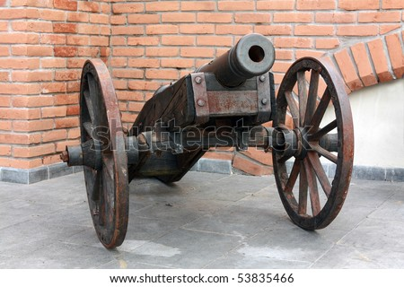 an cannon in a castle - stock photo