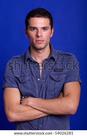 an casual young man portrait over a blue background - stock photo