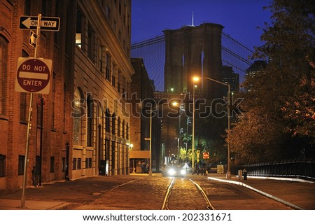 An cobblestone street in DUMBO with Brooklyn Bridge, Brooklyn, New York - stock photo