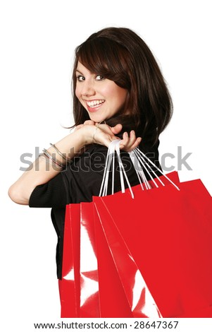 An crazy happy shopping girl holding bags and filled with glee. - stock photo