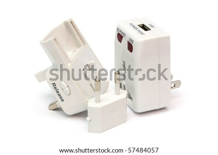 An disassembled universal plug adapter isolated on white background.