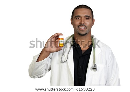 An doctor holding prescription medication in her office - stock photo
