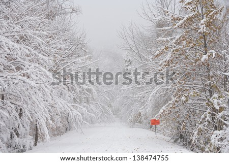 An early autumn snowfall on the Smugglers Notch (Rt. 108) road, Stowe, Vermont, USA - stock photo