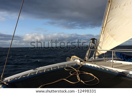 An early morning sail on the Pacific Ocean. - stock photo