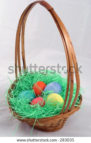 An Easter basket filled with colorful Easter eggs.