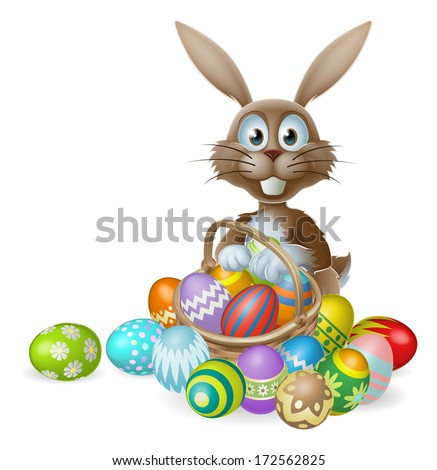 An Easter bunny rabbit with a basket of decorated painted chocolate Easter eggs - stock photo