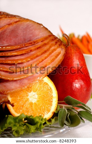 An Easter honey and brown sugar glazed ham with carrots and herbs