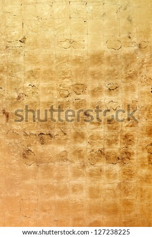 An eerie golden bronze colored grunge texture or background with space for text or image
