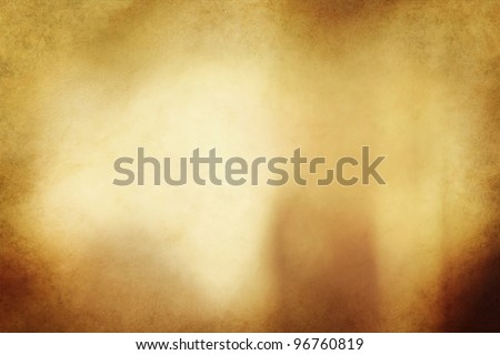 An eerie golden bronze colored grunge texture or background with space for text or image. - stock photo