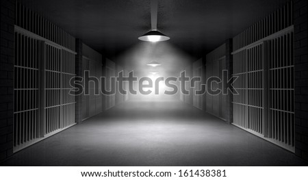 An eerie haunting corridor in a prison at night showing jail cells illuminated by various ominous lights - stock photo