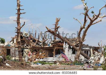 An EF-5 Tornado'd damage is evident in this image of a home which used to be surrounded by large shady oaks.  There is nothing left of the trees except a few broken limbs and the home was destroyed. - stock photo