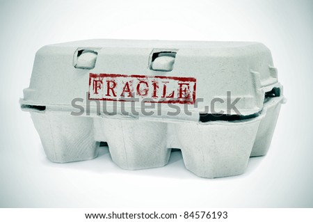 an egg carton with word fragile stamped on it - stock photo