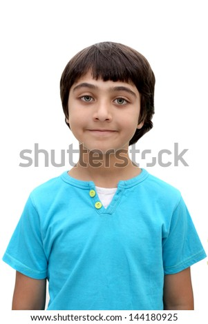 An eight year old brown haired boy with a slight smile - stock photo