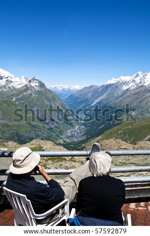 An elderly couple enjoying the view overlooking Zermatt, Switzerland, Picture taken 2008-07-15 - stock photo