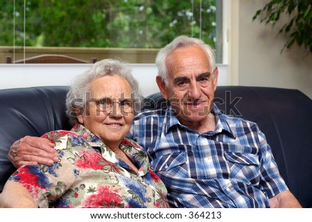 An elderly couple/grandparents. - stock photo
