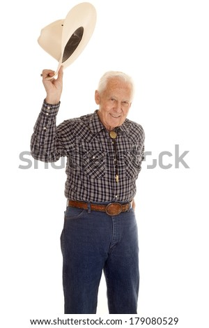 An elderly man holding up his cowboy hat. - stock photo