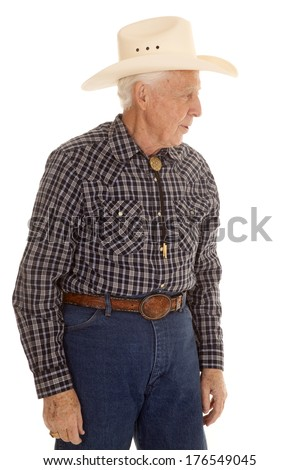 An elderly man in a cowboy hat from the side. - stock photo