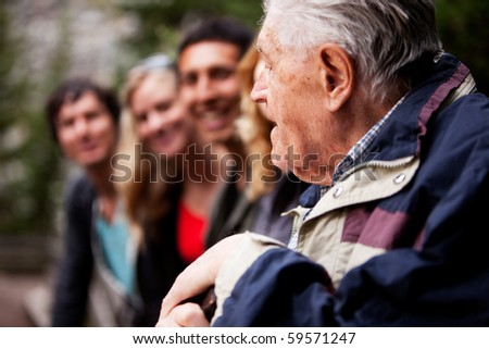 An elderly man telling stories - stock photo