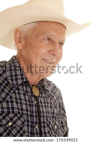 An elderly man up close smiling in a cowboy hat. - stock photo