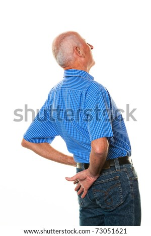 An elderly man with back pain. Senior with pain in the back. - stock photo