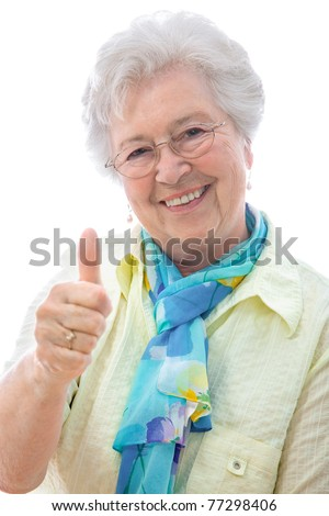 An elderly woman showing thumbs up sign  isolated against white - stock photo