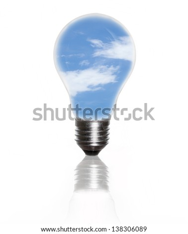 An electric light bulb against blue sky and puffy cloud - stock photo