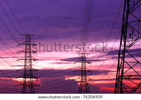 An Electric Pole With Sunset Sky - stock photo