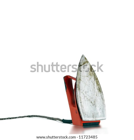 An electric red retro iron from bottom - stock photo