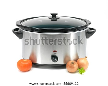 An electric slow cooker on a kitchen bench - stock photo